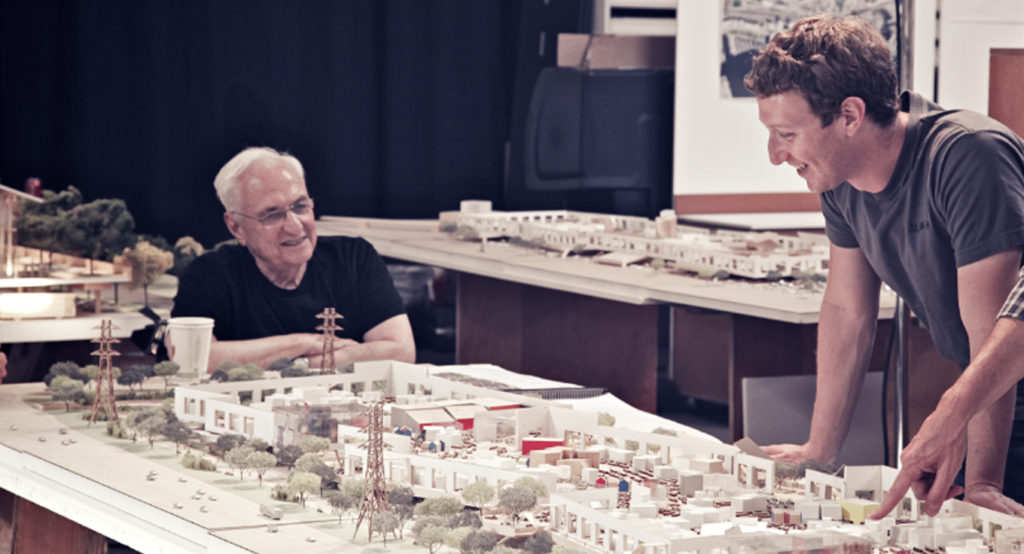 Mark Zuckerberg and Frank Gehry review architectural models of Facebook's collaborative space.