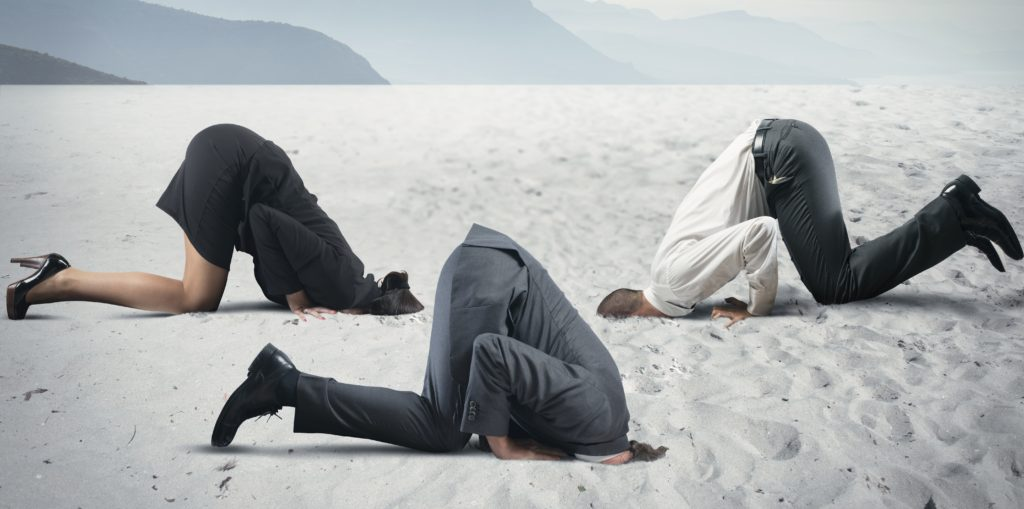 Sticking your head in the sand: A symptom of Groupthink.